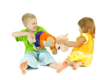 Children divide a toy. A white background stock image