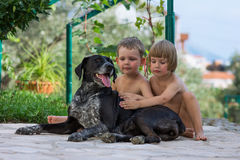 Children with dog Stock Photography