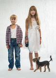 Children with dog Stock Images