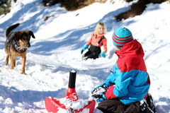 Children and dog in snow Stock Image