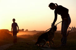 Children with dog at sunset Stock Photos
