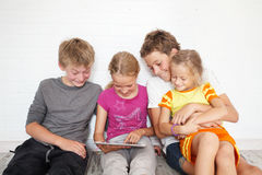 Children and dog with tablet Royalty Free Stock Photo