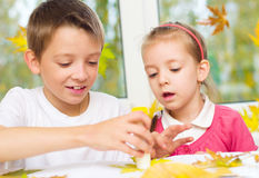 Children doing arts and crafts stock image