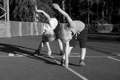 Children doing exercises Royalty Free Stock Photos
