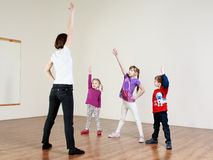Children are doing exercises with a trainer stock images