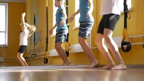 Children doing gymnastic exercises in a gym stock video footage