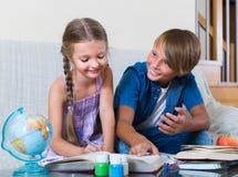 Children doing homework Stock Images