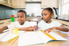 Children doing homework in the kitchen Royalty Free Stock Photo