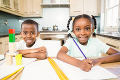 Children doing homework in the kitchen Royalty Free Stock Photography