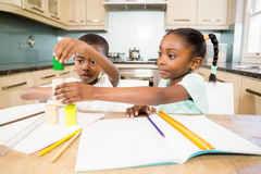 Children doing homework in the kitchen Royalty Free Stock Images