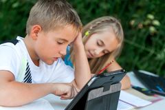 Children Doing Homework Ourdoors. Royalty Free Stock Photography