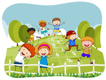 Children doing hopscotch in the park Stock Photos