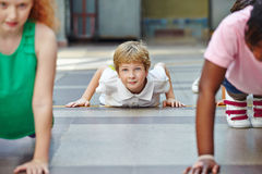 Children doing push ups in PE. In elementary school Royalty Free Stock Photos