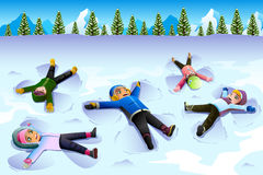 Children Doing Snow Angel During the Winter Stock Photo