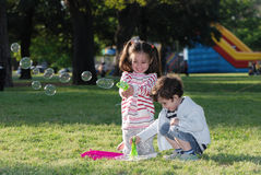 Children doing soap bubbles Royalty Free Stock Photo