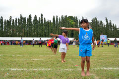 Children doing a teamwork run racing at Kindergarten sport day Royalty Free Stock Photos