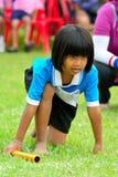 Children doing a teamwork run racing at Kindergarten sport day Stock Photography