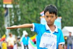 Children doing a teamwork run racing at Kindergarten sport day Royalty Free Stock Images