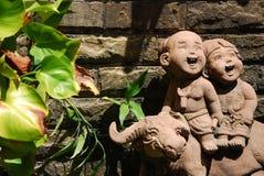 Children doll design in garden Stock Photo
