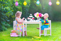 Children at doll tea party Stock Photo