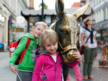 Children with a donkey sculpture. Stock Photography