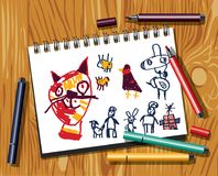 Children doodles draw cat felt pen paper and wood background. Royalty Free Stock Photos