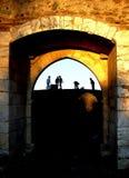 Children and door. Children play together to the door of the castle. Village of Portel, Portugal stock photos
