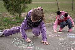 Children draw chalk on the street Stock Photos