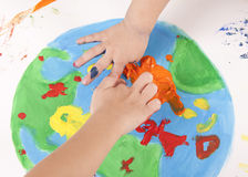 Children draw colored paints globe Stock Photos
