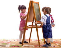 Children draw. With chalk on a blackboard white background Stock Photos