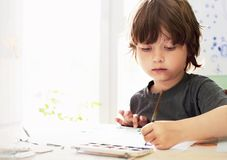 Children draw in home royalty free stock photos