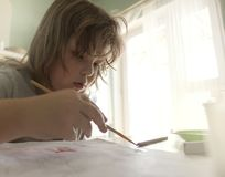 Children draw in home, Boy studying drawing at school Royalty Free Stock Image