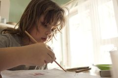 Children draw in home, Boy studying drawing at school stock image