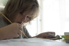 Children draw in home, Boy studying drawing at school Royalty Free Stock Images