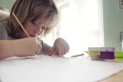Children draw in home, Boy studying drawing at school royalty free stock photography