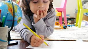 Children draw in home stock video