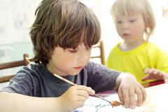 Children draw in home Stock Photos