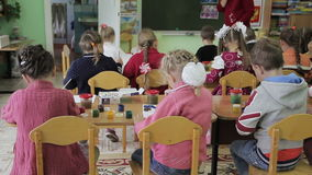 Children draw in kindergarten on paper stock video