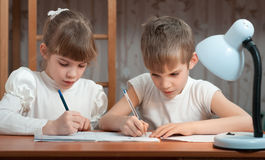 Children draw in a notebook Royalty Free Stock Photography