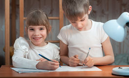 Children draw in a notebook Stock Photos