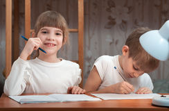 Children draw in a notebook Stock Photography