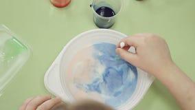 Children draw paints in milk stock video footage