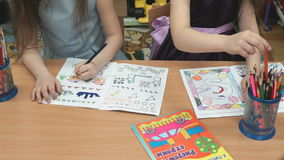 Children draw the the pictures in the copybooks stock footage