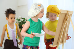 Children draw pictures on an easel stock images