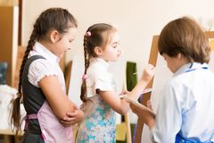 Children draw pictures of easels Stock Photos