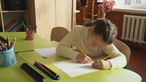 Children draw at school. Children draw while sitting at school stock footage