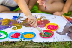 Children draw in summer park. Art concept stock images
