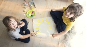 Children draw sun in home, Boy studying drawing at school Royalty Free Stock Image