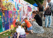 Children draw on a wall in a city park Stock Photos