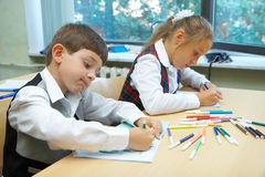 Children drawing. The girl and the boy are drawing stock photos
